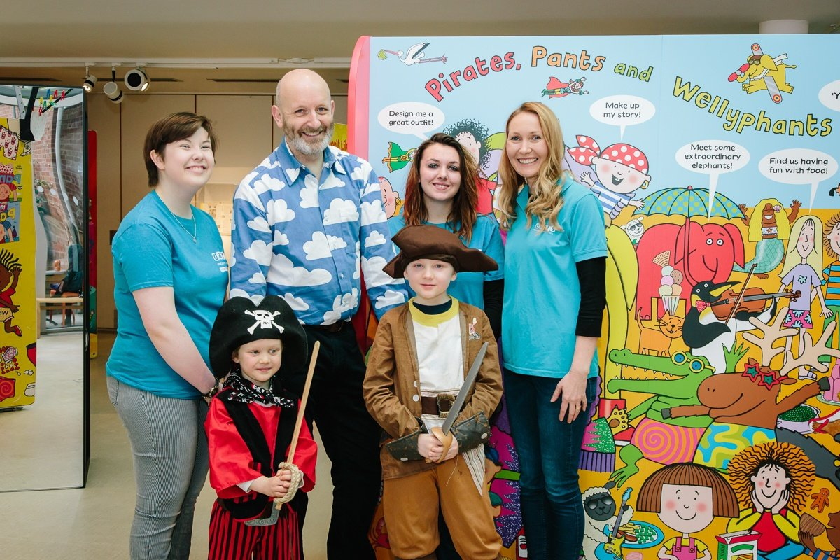 Illustrator, Nick Sharratt, at his exhibition at The Point gallery, Doncaster with Helen Jones, volunteers and children dressed as pirates
