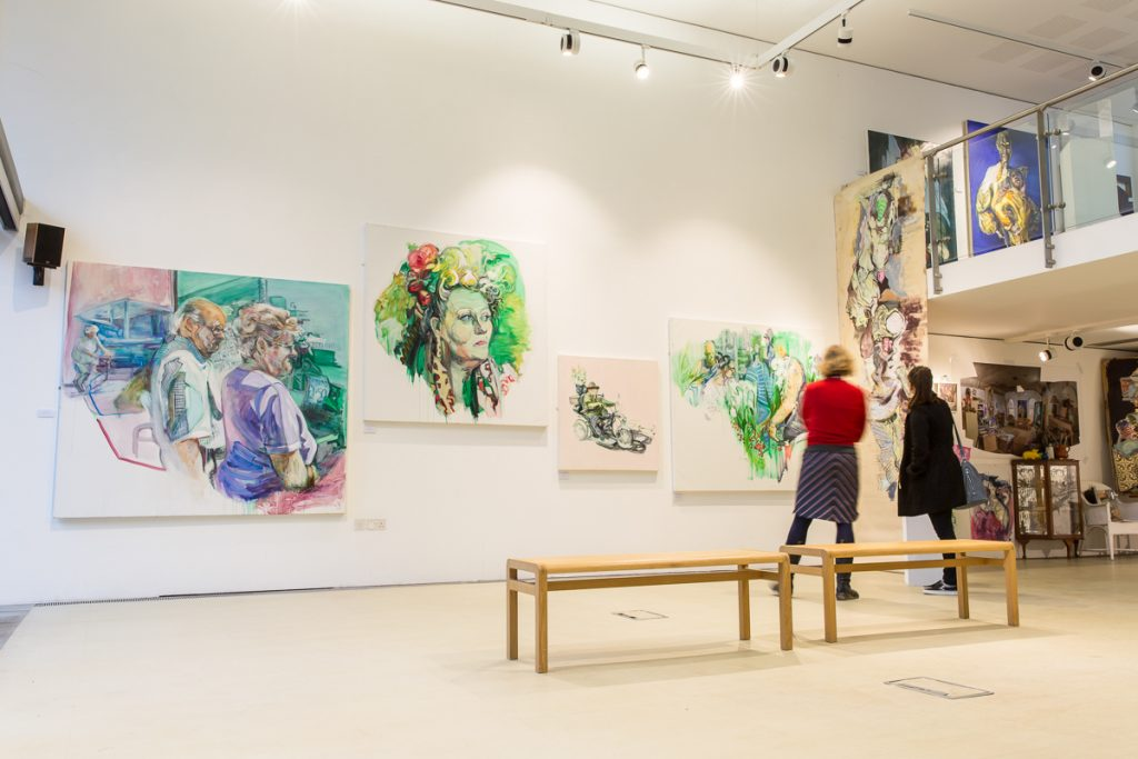 People in the gallery at The Point, Doncaster looking at large paintings