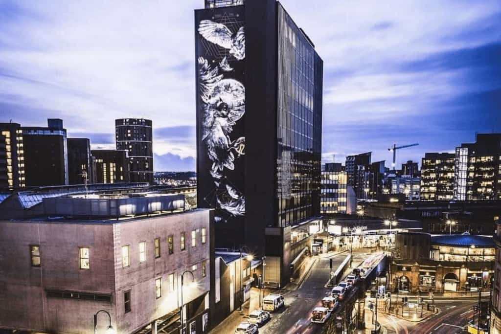 A tall building with graffiti art on the side of it.